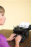 secretary desk - A secretary typing Stock Photo - Premium Royalty-Freenull, Code: 6114-06592699