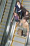 A family stood on an elevator Stock Photo - Premium Royalty-Free, Artist: Blend Images, Code: 6114-06592776