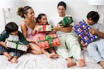 A family in bed with gifts Stock Photo - Premium Royalty-Free, Artist: Kablonk! RM, Code: 6114-06592890