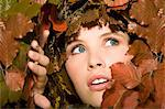 Woman surrounded by leaves Stock Photo - Premium Royalty-Freenull, Code: 6114-06593083