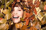Woman surrounded by leaves Stock Photo - Premium Royalty-Freenull, Code: 6114-06593094