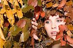 Woman surrounded by leaves Stock Photo - Premium Royalty-Freenull, Code: 6114-06593115