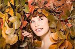 Woman and leaves Stock Photo - Premium Royalty-Free, Artist: Cultura RM, Code: 6114-06593129
