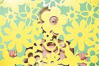pattern (man made design) - Woman peeking through cutout Stock Photo - Premium Royalty-Freenull, Code: 6114-06593131