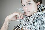 Portrait of a woman wearing recycled accessories Stock Photo - Premium Royalty-Free, Artist: Blend Images, Code: 6114-06593175