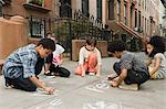 Kids drawing on sidewalk Stock Photo - Premium Royalty-Freenull, Code: 6114-06593270