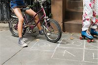 Kids with bicycle and rollerskates Stock Photo - Premium Royalty-Freenull, Code: 6114-06593271