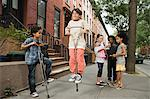 Boy on a pogo stick Stock Photo - Premium Royalty-Free, Artist: ableimages, Code: 6114-06593272