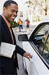 Businessman by car Stock Photo - Premium Royalty-Free, Artist: CulturaRM, Code: 6114-06593415