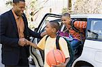 Father and sons leaving car Stock Photo - Premium Royalty-Free, Artist: Kevin Dodge, Code: 6114-06593417
