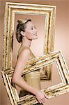 Woman carrying picture frames Stock Photo - Premium Royalty-Free, Artist: CulturaRM, Code: 6114-06593597