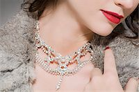 Woman wearing a diamond necklace Stock Photo - Premium Royalty-Freenull, Code: 6114-06593634