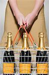 Woman buying champagne Stock Photo - Premium Royalty-Free, Artist: photo division, Code: 6114-06593638