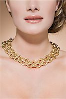 Woman wearing a gold necklace Stock Photo - Premium Royalty-Freenull, Code: 6114-06593648