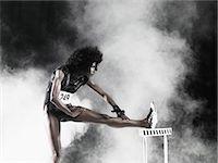 A hurdler stretching Stock Photo - Premium Royalty-Freenull, Code: 6114-06593687