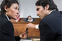 A lawyer and defendant talking Stock Photo - Premium Royalty-Freenull, Code: 6114-06593924