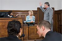 A lawyer and a judge arguing Stock Photo - Premium Royalty-Freenull, Code: 6114-06593952