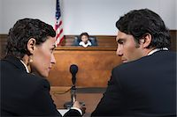 A lawyer and defendant talking Stock Photo - Premium Royalty-Freenull, Code: 6114-06593958