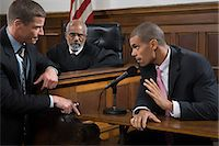 A lawyer questioning a suspect Stock Photo - Premium Royalty-Freenull, Code: 6114-06593969