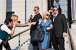 Body guards protecting a woman Stock Photo - Premium Royalty-Free, Artist: Robert Harding Images, Code: 6114-06593974