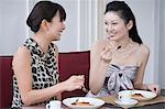 Two women having dessert Stock Photo - Premium Royalty-Free, Artist: Mitch Tobias, Code: 6114-06594041