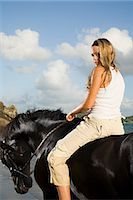 Portrait of a woman on a horse Stock Photo - Premium Royalty-Freenull, Code: 6114-06594165