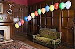 Balloons floating in a lounge Stock Photo - Premium Royalty-Free, Artist: ableimages, Code: 6114-06594228