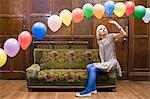 A young woman looking at balloons Stock Photo - Premium Royalty-Free, Artist: Cultura RM, Code: 6114-06594236