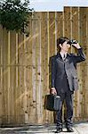 A businessman using binoculars Stock Photo - Premium Royalty-Free, Artist: Cultura RM, Code: 6114-06594346