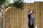 A businessman using binoculars Stock Photo - Premium Royalty-Free, Artist: Blend Images, Code: 6114-06594352