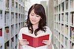 Female student reading in library Stock Photo - Premium Royalty-Free, Artist: CulturaRM, Code: 6114-06594365