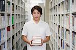 Young man in library Stock Photo - Premium Royalty-Free, Artist: CulturaRM, Code: 6114-06594442