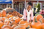 Portrait of a girl and a pumpkin Stock Photo - Premium Royalty-Free, Artist: CulturaRM, Code: 6114-06594560