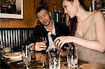 Couple drinking wine in a bar Stock Photo - Premium Royalty-Free, Artist: Jose Luis Stephens, Code: 6114-06594752