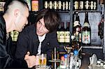 Young men talking in a bar Stock Photo - Premium Royalty-Free, Artist: Blend Images, Code: 6114-06594773