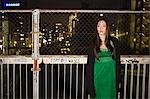Japanese woman standing by a fence Stock Photo - Premium Royalty-Free, Artist: Uwe Umstätter, Code: 6114-06594789