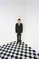 Businessman in corner Stock Photo - Premium Royalty-Freenull, Code: 6114-06594908