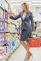 Woman in supermarket Stock Photo - Premium Royalty-Freenull, Code: 6114-06594998