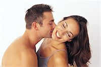 Couple kissing Stock Photo - Premium Royalty-Freenull, Code: 6114-06595600
