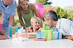 Little boy and his family at his birthday party Stock Photo - Premium Royalty-Free, Artist: Blend Images, Code: 6114-06595866