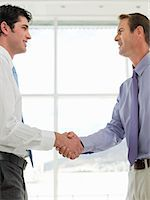 Businessmen shaking hands Stock Photo - Premium Royalty-Freenull, Code: 6114-06595957