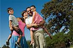 Smiling family in park Stock Photo - Premium Royalty-Free, Artist: dk & dennie cody, Code: 6114-06595970