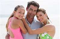 Parents and young daughter at the beach Stock Photo - Premium Royalty-Freenull, Code: 6114-06596083
