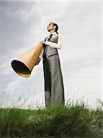 Businesswoman with megaphone Stock Photo - Premium Royalty-Freenull, Code: 6114-06596190
