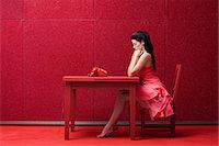 red chair - Woman in red room with telephone Stock Photo - Premium Royalty-Freenull, Code: 6114-06596273