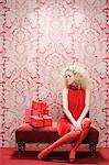 Young woman looking at red gifts Stock Photo - Premium Royalty-Free, Artist: CulturaRM, Code: 6114-06596276