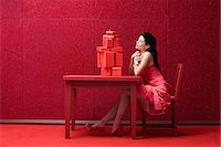 red chair - Woman in red room with gifts Stock Photo - Premium Royalty-Freenull, Code: 6114-06596285