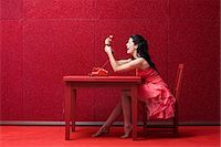 red chair - Woman in red room with telephone Stock Photo - Premium Royalty-Freenull, Code: 6114-06596305