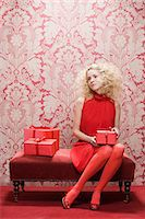 Young woman with red gifts Stock Photo - Premium Royalty-Freenull, Code: 6114-06596334
