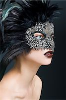 Woman wearing mask of feathers Stock Photo - Premium Royalty-Freenull, Code: 6114-06596417